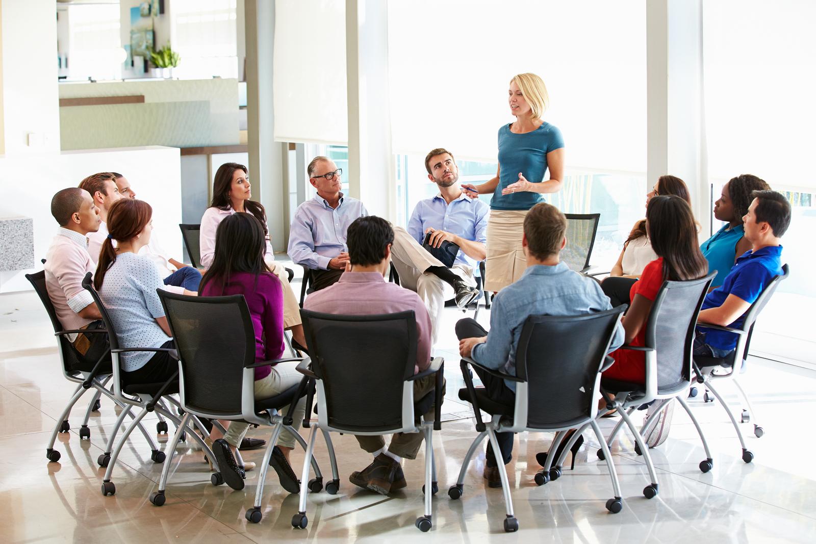 bigstock-Businesswoman-Addressing-Multi-59300408